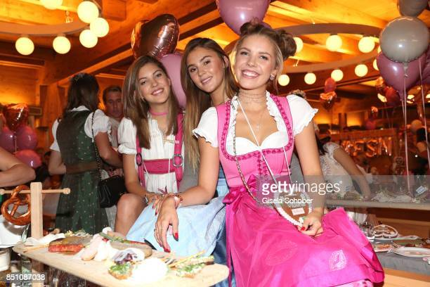Paulina Swarovski Stefanie Giesinger and Victoria Swarovski at the 'Madlwiesn' event during the Oktoberfest at Theresienwiese on September 21 2017 in...