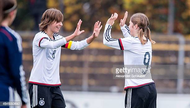 Pauline Berning of Germany celebrates the second goal for her team with Lena Sophie Oberdorf of Germany during the international friendly match...