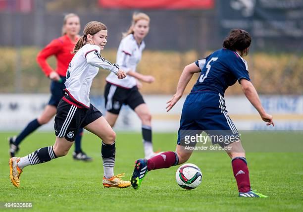 Pauline Berning of Germany challenges Georgie Adderley of Scotland during the international friendly match between U15 Girl's Germany and U15 Girl's...