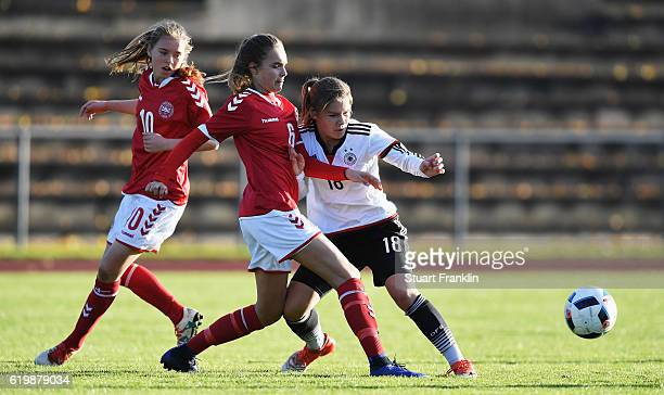 Pauline Berning of Germany is challenged by Selma Svendsen of Denmark during the International Friendly match between U16 Girl's Germany and U16...