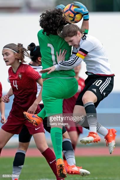 Pauline Berning of Germany U16 Girls challenges Patricia Leitão and Joana Lourença of Portugal U16 Girls during the match between U16 Girls...