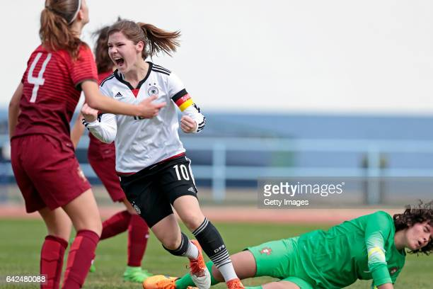 Pauline Berning of Germany U16 Girls scores a goal when challenges Joana Lourença and Patricia Leitão of Portugal U16 Girls during the match between...