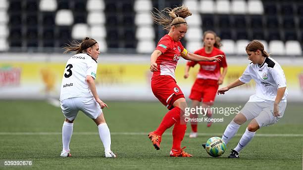 Pauline Berning of Guetersloh challenges Vanessa Ziegler of Freiburg during the U17 Girl's German Championship Semi Final Second Leg match between...