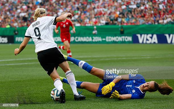 Pauline Bremer of Germany beats goalie Kailen Sheridan of Canada to score the first goal for Germany during the FIFA U20 Women's World Cup Canada...