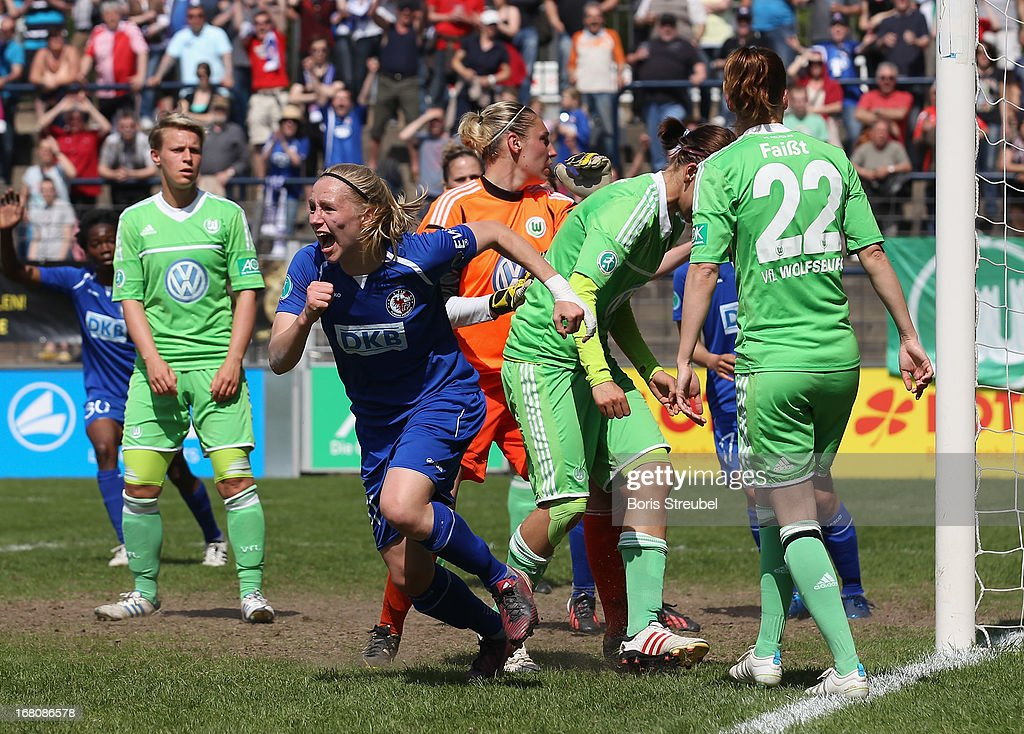 Pauline Bremer of Potsdam (C) celebrates after scoring her team's second goal during the Women's Bundesliga match between 1. FFC Turbine Potsdam and VfL Wolfsburg on May 5, 2013 in Potsdam, Germany.