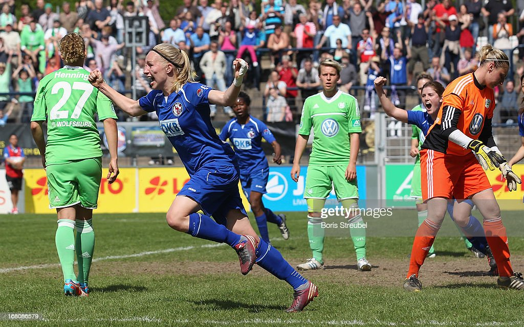 Pauline Bremer of Potsdam (2nd L) celebrates after scoring her team's second goal during the Women's Bundesliga match between 1. FFC Turbine Potsdam and VfL Wolfsburg on May 5, 2013 in Potsdam, Germany.