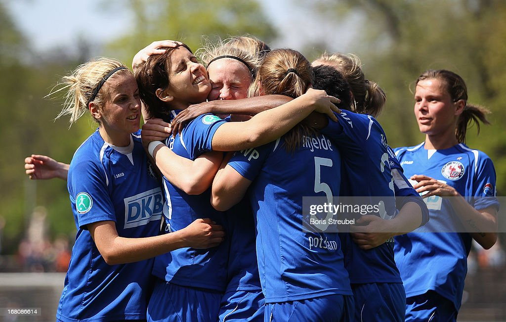 Pauline Bremer of Potsdam (C) celebrates with team-mates after scoring their team's second goal during the Women's Bundesliga match between 1. FFC Turbine Potsdam and VfL Wolfsburg on May 5, 2013 in Potsdam, Germany.