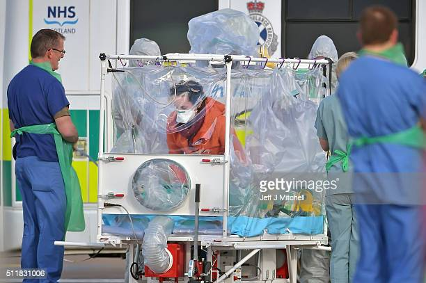 Pauline Cafferkey enters an isolation tent before boarding a RAF Hercules at Glasgow Airport on February 232016 in GlasgowScotland The RAFHercules...