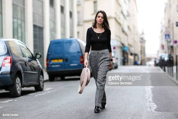 Pauline Darris Founder of the accessories brand Darris wears a Uniqlo black top Saint Laurent YSL wool gray pants a Hermes bracelet a Darris Paris...
