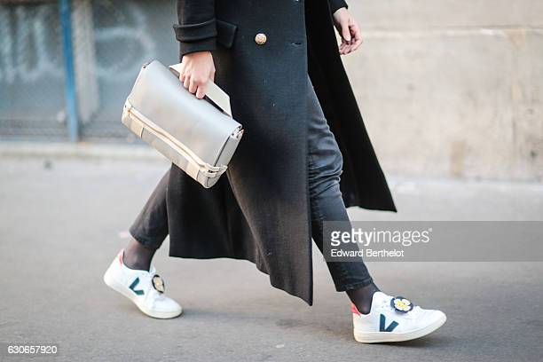 Pauline Darris founder of the Darris brand is wearing Veja shoes with Darris flowers Cos blue denim jeans an Other Stories gray pull over a Hermes...