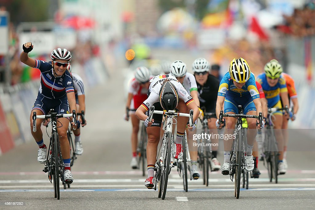 Pauline FerrandPrevot of France celebrates winning the Women's Elite Road Race on day six of the UCI Road World Championships on September 27 2014 in...