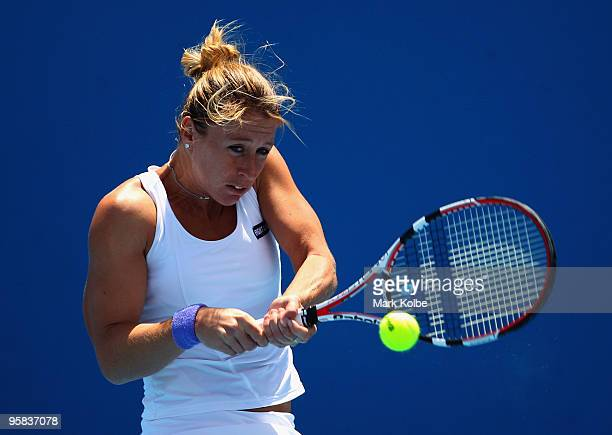 Pauline Parmentier of France plays a backhand in her first round match against Elena Baltacha of Great Britain during day one of the 2010 Australian...