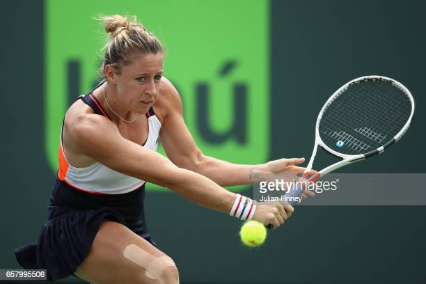 Pauline Parmentier of France plays a backhand in her match against Johanna Konta of Great Britain at Crandon Park Tennis Center on March 26 2017 in...