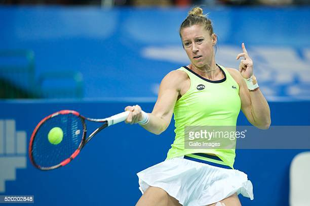 Pauline Parmentier of France plays a forehand against Dominika Cibulkova of Slovakia during the WTA Katowice Open second semifinal match on April 9...