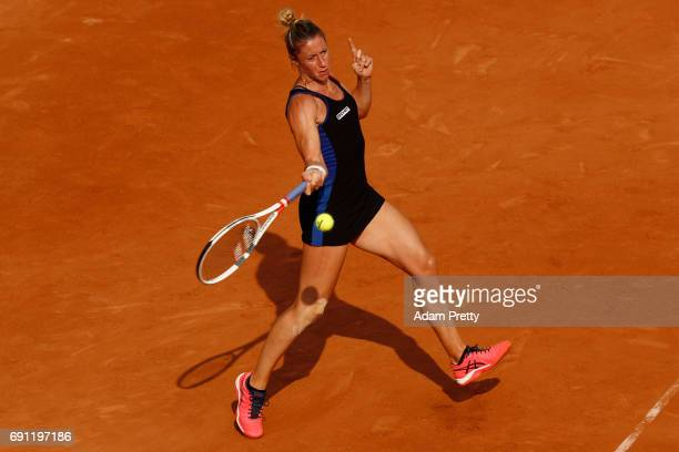 Pauline Parmentier of France plays a forehand during the ladies singles second round match against Carina Witthoeft of Germany on day five of the...