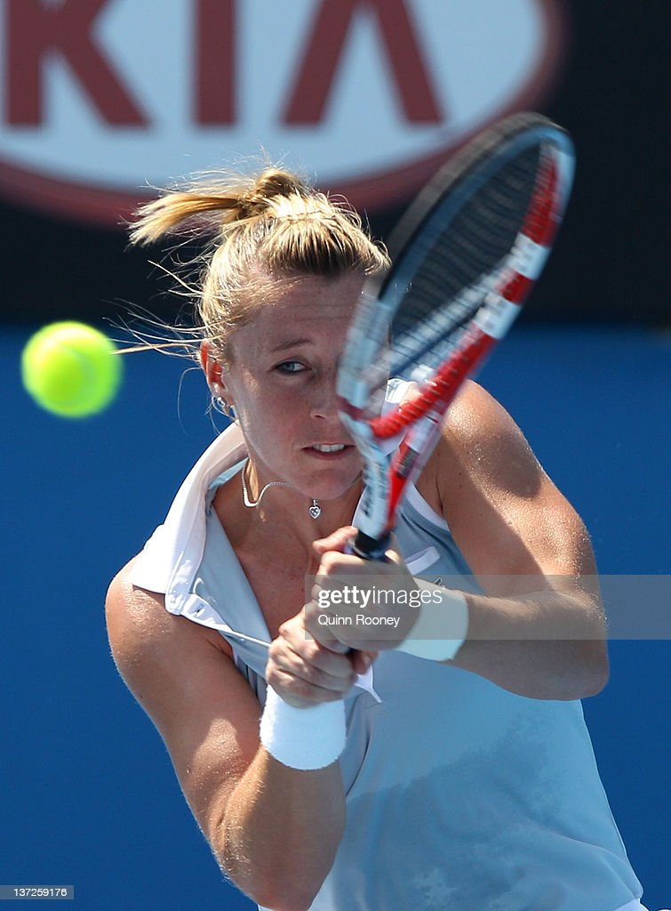 <a gi-track='captionPersonalityLinkClicked' href=/galleries/search?phrase=Pauline+Parmentier&family=editorial&specificpeople=607686 ng-click='$event.stopPropagation()'>Pauline Parmentier</a> of France plays a forehand in her second round match against Monica Niculescu of Romania during day three of the 2012 Australian Open at Melbourne Park on January 18, 2012 in Melbourne, Australia.