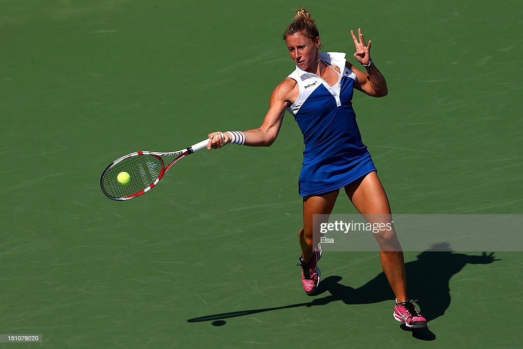 <a gi-track='captionPersonalityLinkClicked' href=/galleries/search?phrase=Pauline+Parmentier&family=editorial&specificpeople=607686 ng-click='$event.stopPropagation()'>Pauline Parmentier</a> of France returns a shot against Petra Kvitova of the Czech Republic during their women's singles third round match on Day Five of the 2012 US Open at USTA Billie Jean King National Tennis Center on August 31, 2012 in the Flushing neigborhood of the Queens borough of New York City.