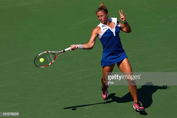 Pauline Parmentier of France returns a shot against Petra Kvitova of the Czech Republic during their women's singles third round match on Day Five of...