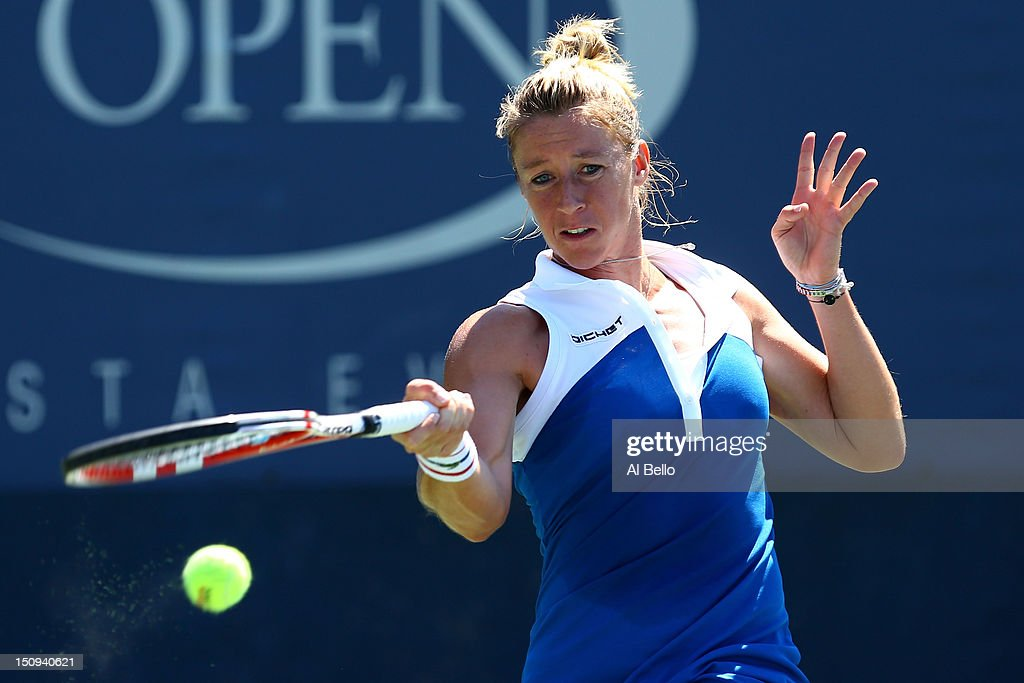 <a gi-track='captionPersonalityLinkClicked' href=/galleries/search?phrase=Pauline+Parmentier&family=editorial&specificpeople=607686 ng-click='$event.stopPropagation()'>Pauline Parmentier</a> of France returns a shot against Yanina Wickmayer of Belgium during their women's singles second round match on Day Three of the 2012 US Open at USTA Billie Jean King National Tennis Center on August 29, 2012 in the Flushing neigborhood of the Queens borough of New York City.