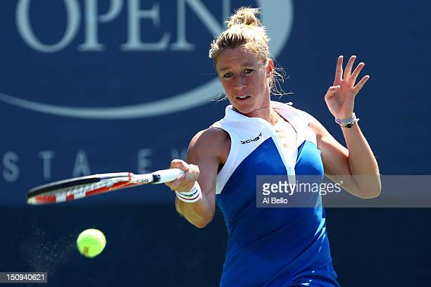 Pauline Parmentier of France returns a shot against Yanina Wickmayer of Belgium during their women's singles second round match on Day Three of the...