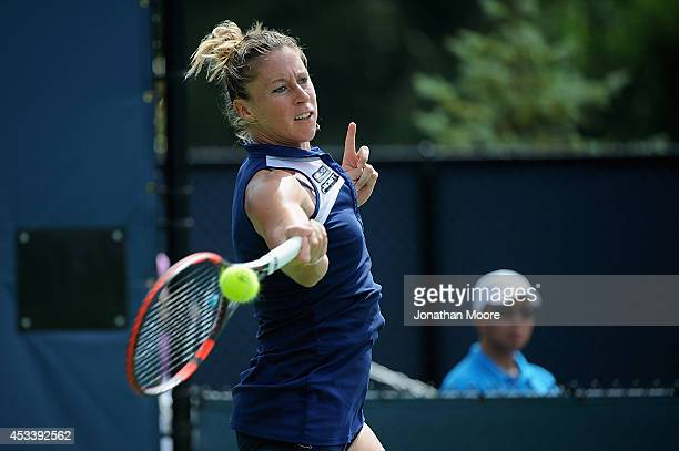 Pauline Parmentier of France returns to Karolina Pliskova of the Czech Republic during day 1 of the Western and Southern Open on August 9 2014 in...
