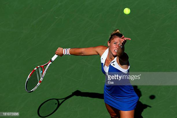 Pauline Parmentier of France serves against Petra Kvitova of the Czech Republic during their women's singles third round match on Day Five of the...