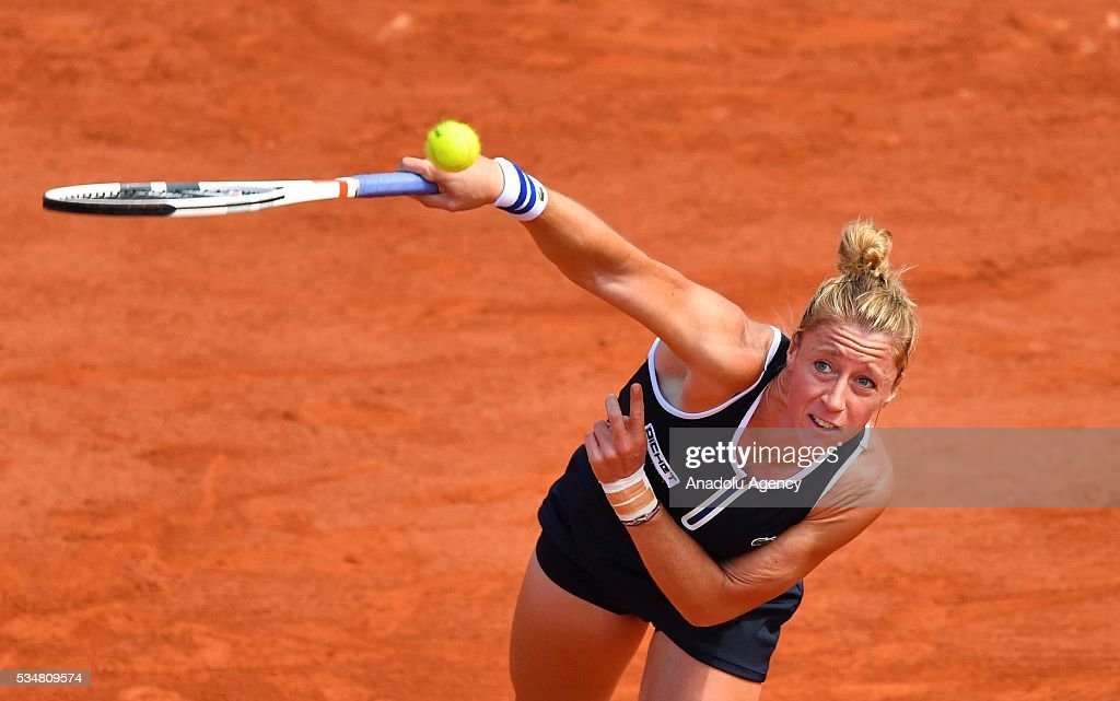Pauline Parmentier of France serves to Timea Bacsinszky (not seen) of Switzerland during the women's single third round match at the French Open tennis tournament at Roland Garros Stadium in Paris, France on May 28, 2016.