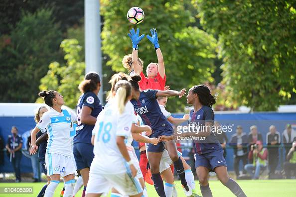 Pauline Peyraud Magnin of Marseille collects the ball under pressure during the women's French D1 league match between PSG and Olympique de Marseille...