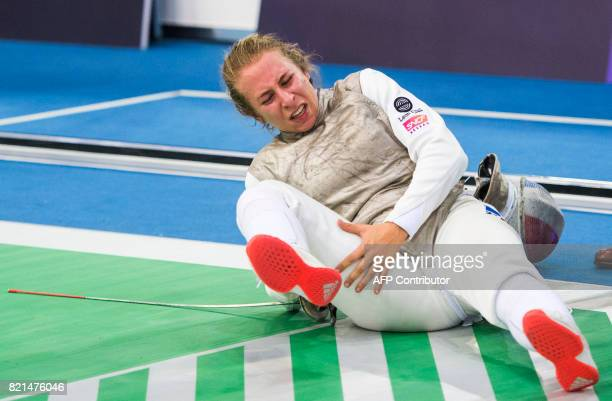 Pauline Ranvier of France lays on the piste during the qualification France vs Germany of the Women's Team Foil competition at the World Fencing...