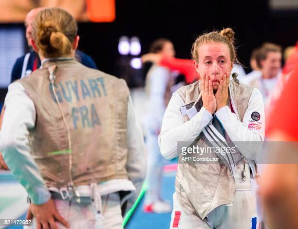 Pauline Ranvier of France reacts after losing her match of the Women's Team Foil competition France vs Germany at the World Fencing Championships on...