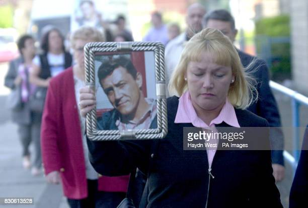 Pauline the sister of James Ashley arrives at Wolverhampton Crown Court holding a picture of her dead brother Three senior Sussex Police officers...