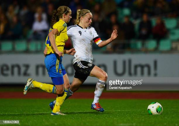 PaulineMarie Bremer of Germany is challenged by Elin Karlsson of Sweden during the women's U19 international friendly match between Germany and...