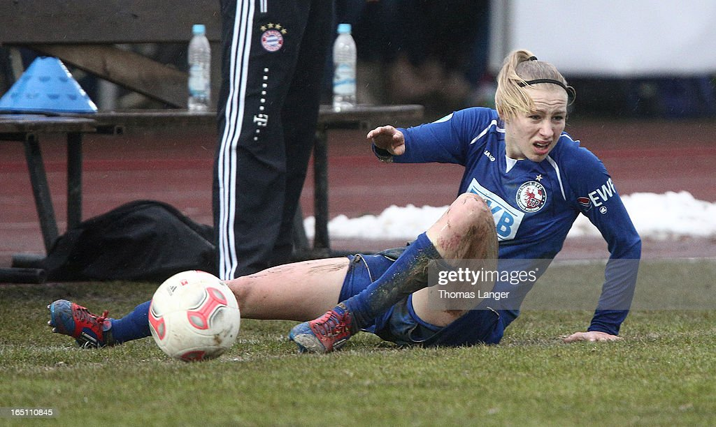 Pauline-Marie Bremer of Potsdam lies on the ground during the Women's Soccer Bundesliga Match between Bayern Muenchen and 1. FFC Turbine Potsdam on March 30, 2012 in Aschheim, Germany.