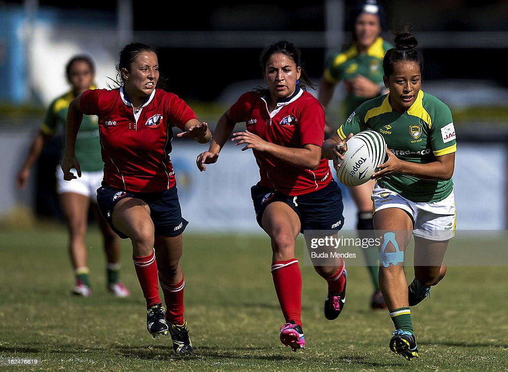 Paulinha Ishibashi of Brazil (green jersey) fights for the ball with a player of Chile during a rugby match as part of the Rio Sevens 2013 - South American Championship at the Gavea Stadium on February 23, 2013 in Rio de Janeiro, Brazil.