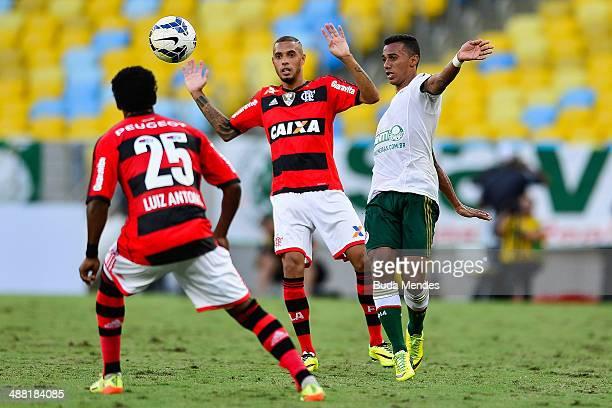 Paulinho and Luis Antonio of Flamengo struggles for the ball with Juninho of Palmeiras during a match between Flamengo and Palmeiras as part of...