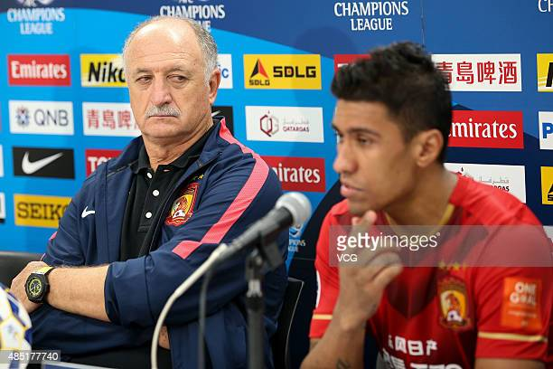 Paulinho and Luiz Felipe Scolari head coach of Guangzhou Evergrande attend a press conference after the AFC Champions League quarterfinal football...