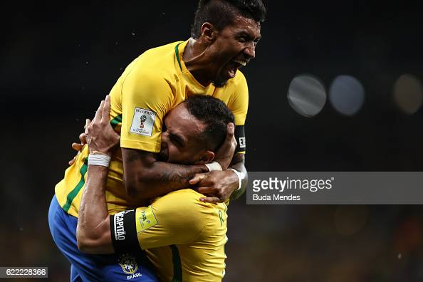 Paulinho and Renato Augusto of Brazil celebrate a scored goal during a match between Brazil and Argentina as part of 2018 FIFA World Cup Russia...