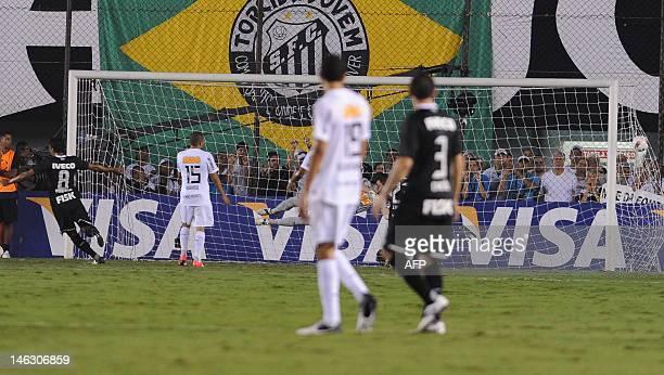 Paulinho Becerra of Brazilian's Corinthians celebrates after scoring against Brazilian Santos during their Copa Libertadores football semifinal first...