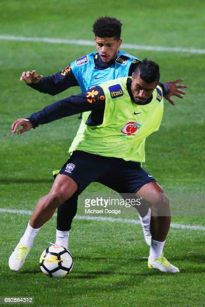 Paulinho competes for the ball in front of Philippe Coutinho during a Brazil training session at Lakeside Stadium on June 6 2017 in Melbourne...