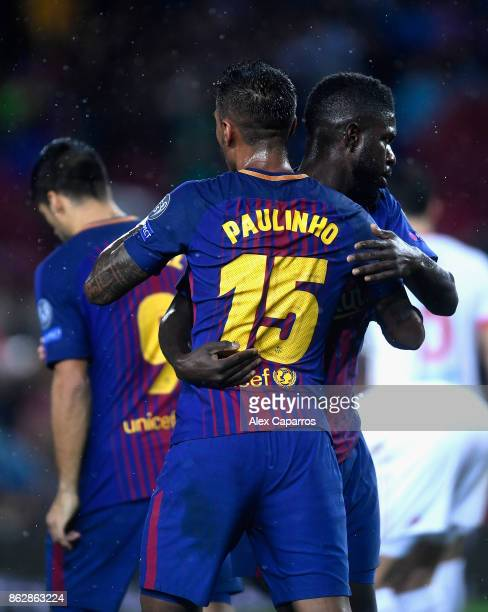 Paulinho of Barcelona and Samuel Umtiti of Barcelona celebrates their sides first goal during the UEFA Champions League group D match between FC...
