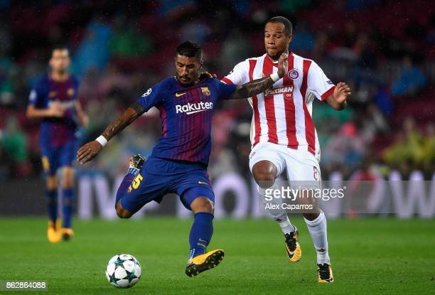 Paulinho of Barcelona and Vadis Odjidja of Olympiacos in action during the UEFA Champions League group D match between FC Barcelona and Olympiakos...