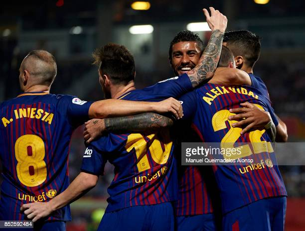 Paulinho of Barcelona celebrates with his teammates during the La Liga match between Girona and Barcelona at Municipal de Montilivi Stadium on...