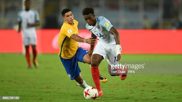 Paulinho of Brazil and Callum HudsonOdoi of England in action during the FIFA U17 World Cup India 2017 Semi Final match between Brazil and England at...