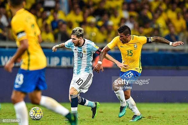 Paulinho of Brazil and Messi of Argentina battle for the ball during a match between Brazil and Argentina as part 2018 FIFA World Cup Russia...