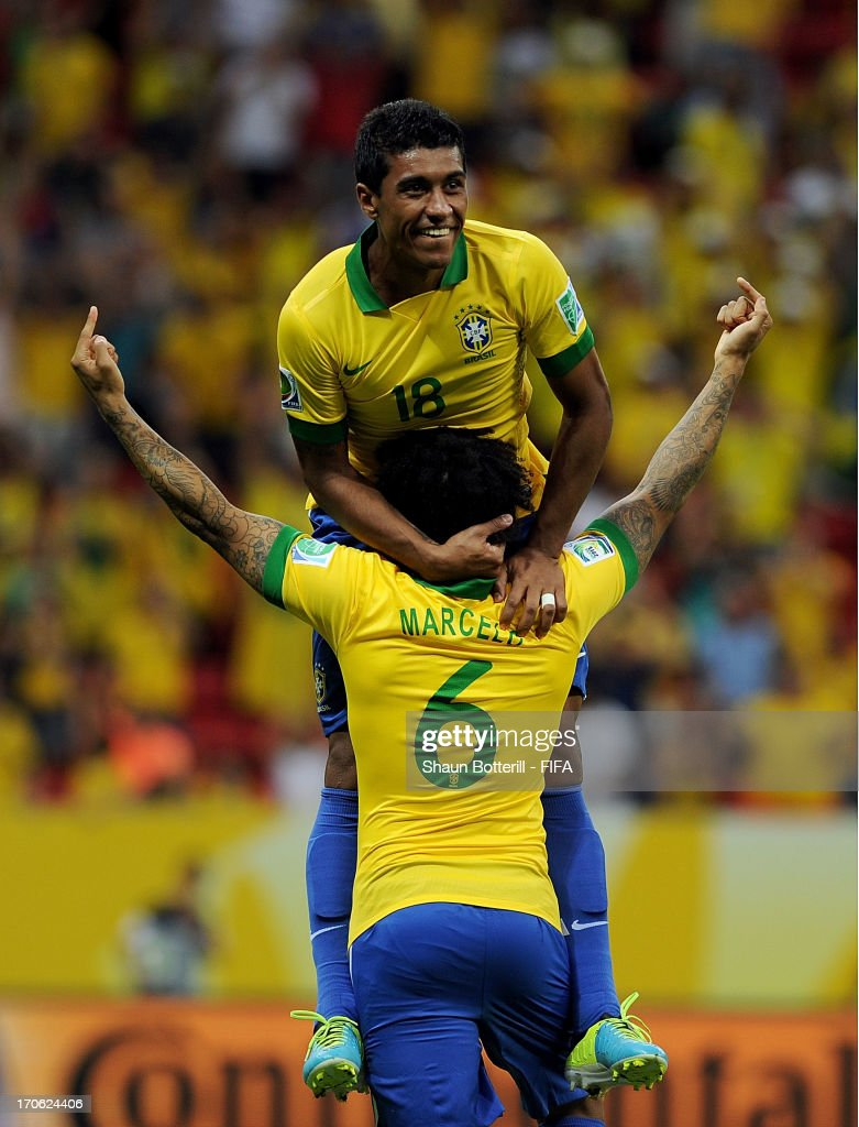 Paulinho of Brazil celebrates scoring his team's second goal with team-mate Marcelo during the FIFA Confederations Cup Brazil 2013 Group A match between Brazil and Japan at National Stadium on June 15, 2013 in Brasilia, Brazil.