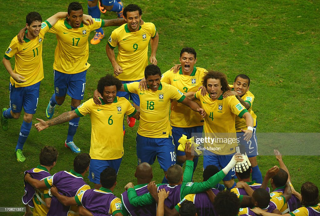 Paulinho of Brazil celebrates with his team-mates after scoring his team's second goal during the FIFA Confederations Cup Brazil 2013 Group A match between Brazil and Japan at National Stadium on June 15, 2013 in Brasilia, Brazil.