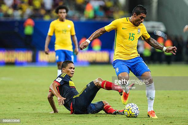 Paulinho of Brazil dribbles past Carlos Bacca of Colombia during a match between Brazil and Colombia as part of FIFA 2018 World Cup Qualifiers at...