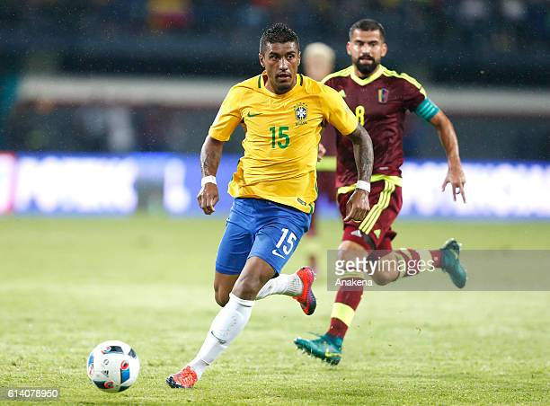 Paulinho of Brazil dribbles past Tomas Rincon of Venezuela during a match between Venezuela and Brazil as part of FIFA 2018 World Cup Qualifiers at...