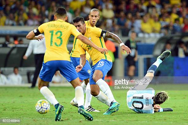 Paulinho of Brazil fights for the ball with Lionel Messi of Argentina during a match between Argentina and Brazil as part of FIFA 2018 World Cup...