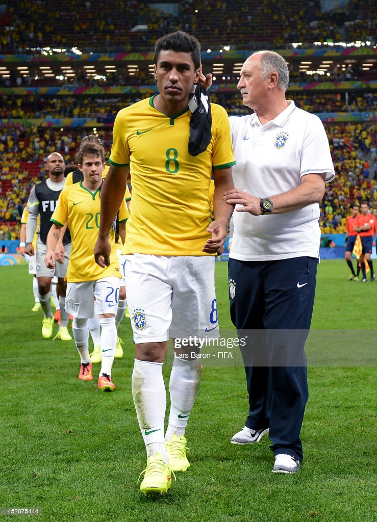 Paulinho of Brazil is consoled by head coach Luiz Felipe Scolari of Brazil after the 2014 FIFA World Cup Brazil 3rd Place Playoff match between Brazil and Netherlands at Estadio Nacional on July 12, 2014 in Brasilia, Brazil.